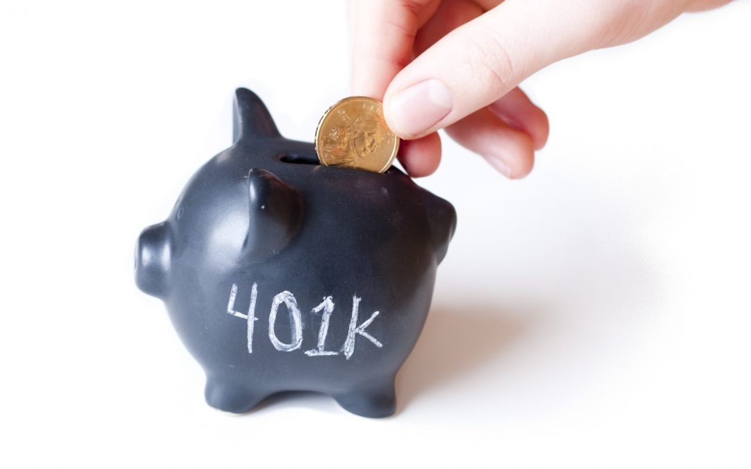 "Gold coin is put into piggy bank marked ""401k."" Illustrates tax-sheltered savings"